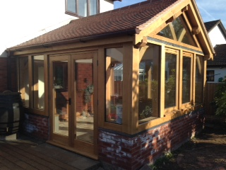 Chepstow oak framed conservatory sat on brick wall