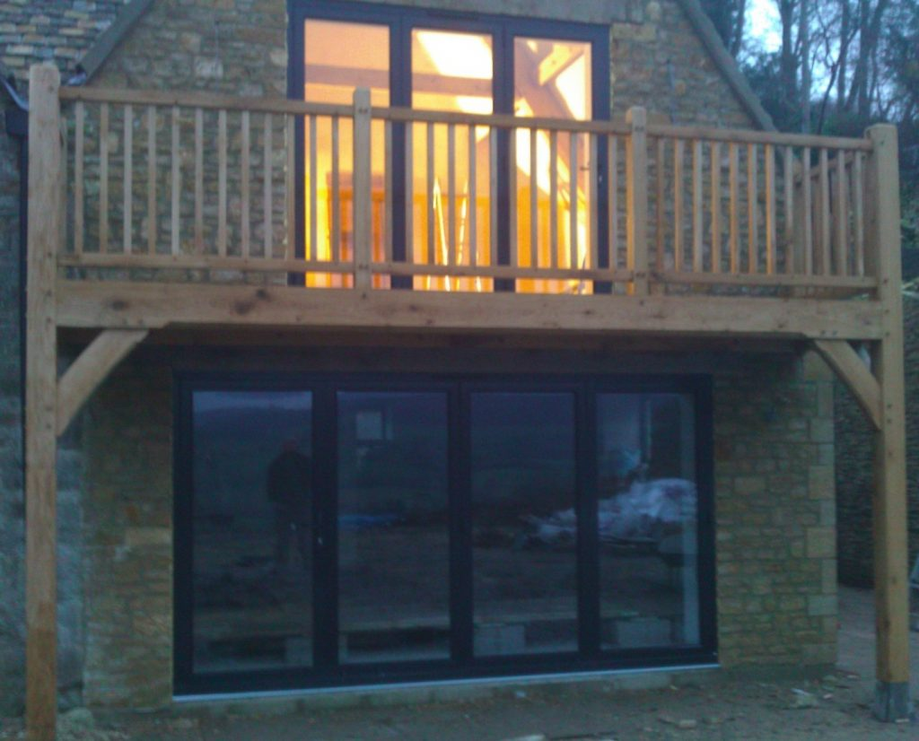Oak framed balcony with oak spindles on a barn end