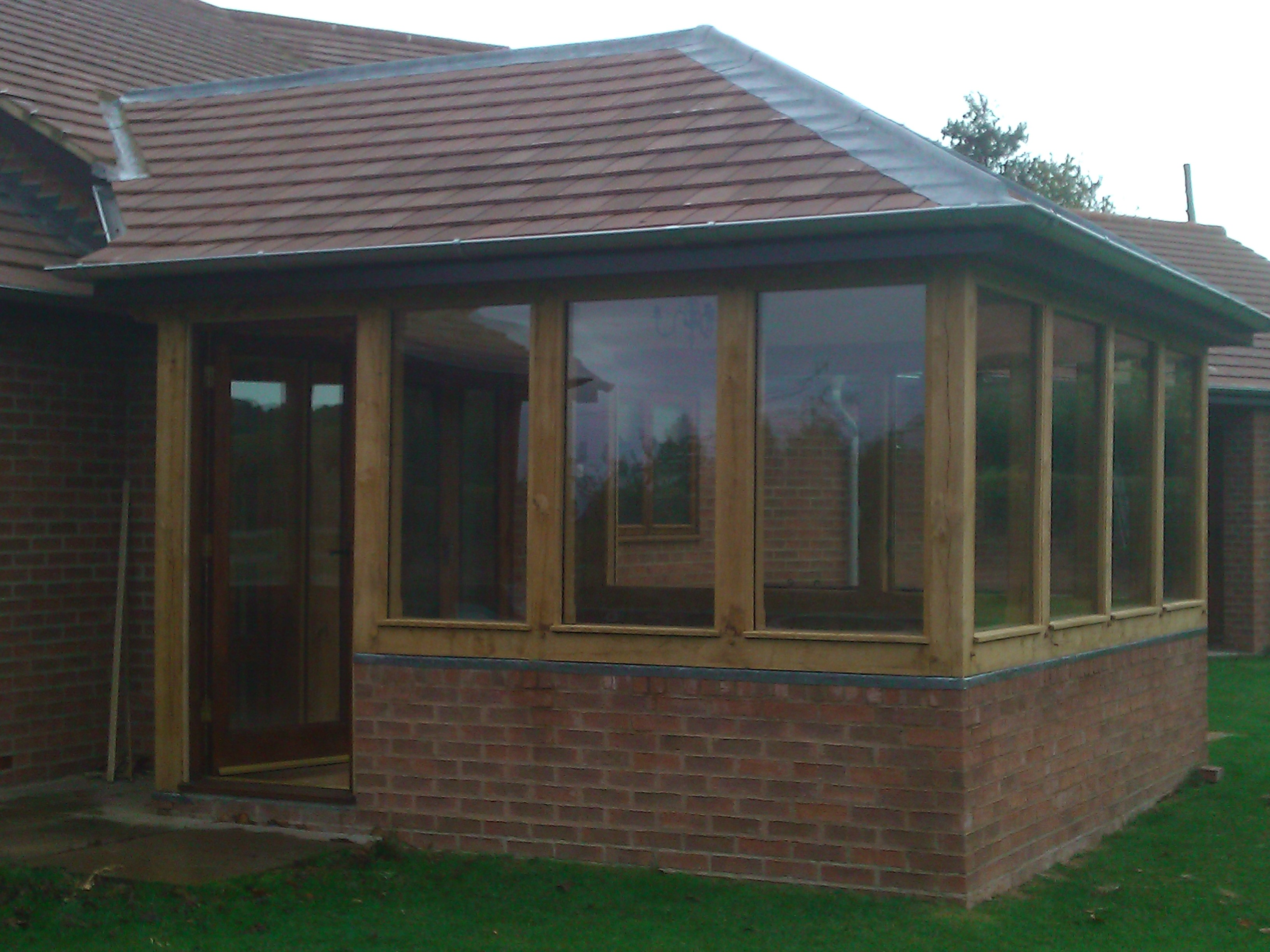 Oak framed conservatory with hipped roof