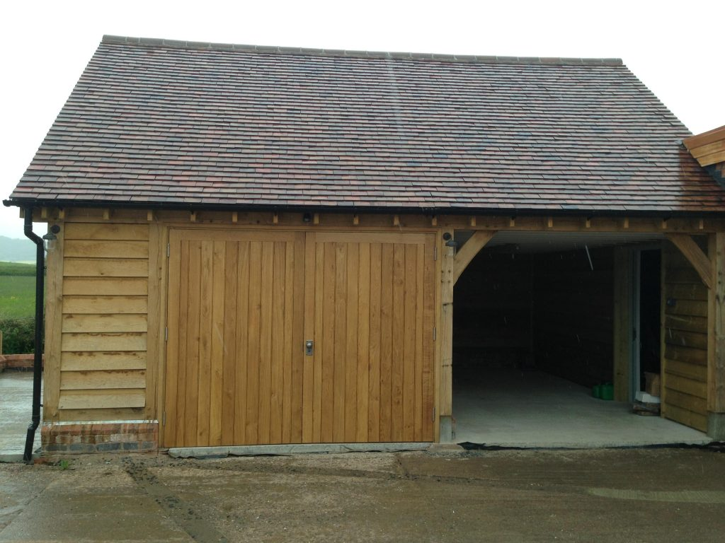 2 bay oak framed garage side log store