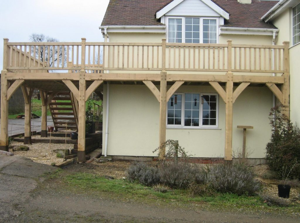 Long oak balcony with wrap around oak stairs