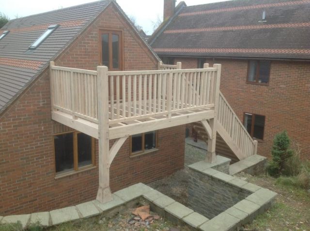 Oak balcony on brick garage