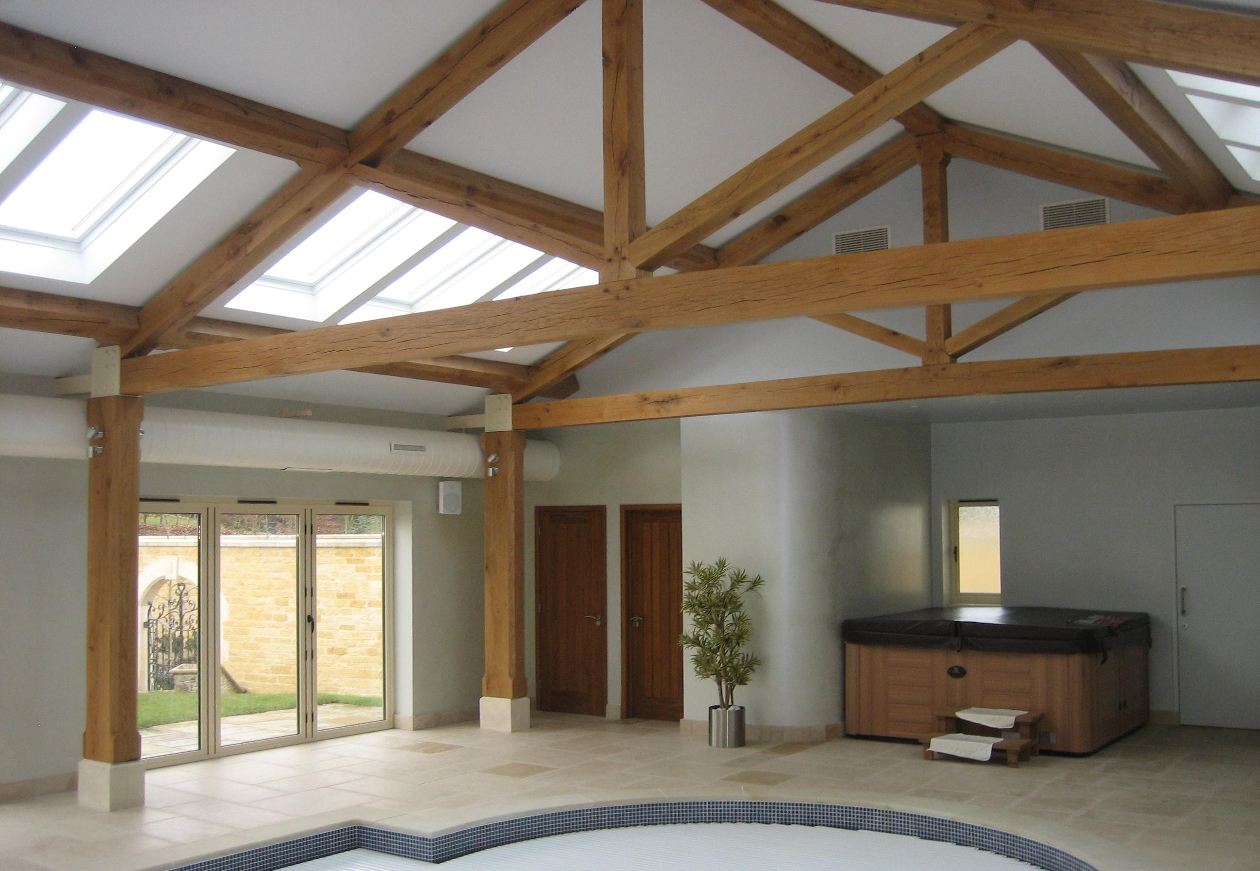 Oak king post trusses over swimming pool