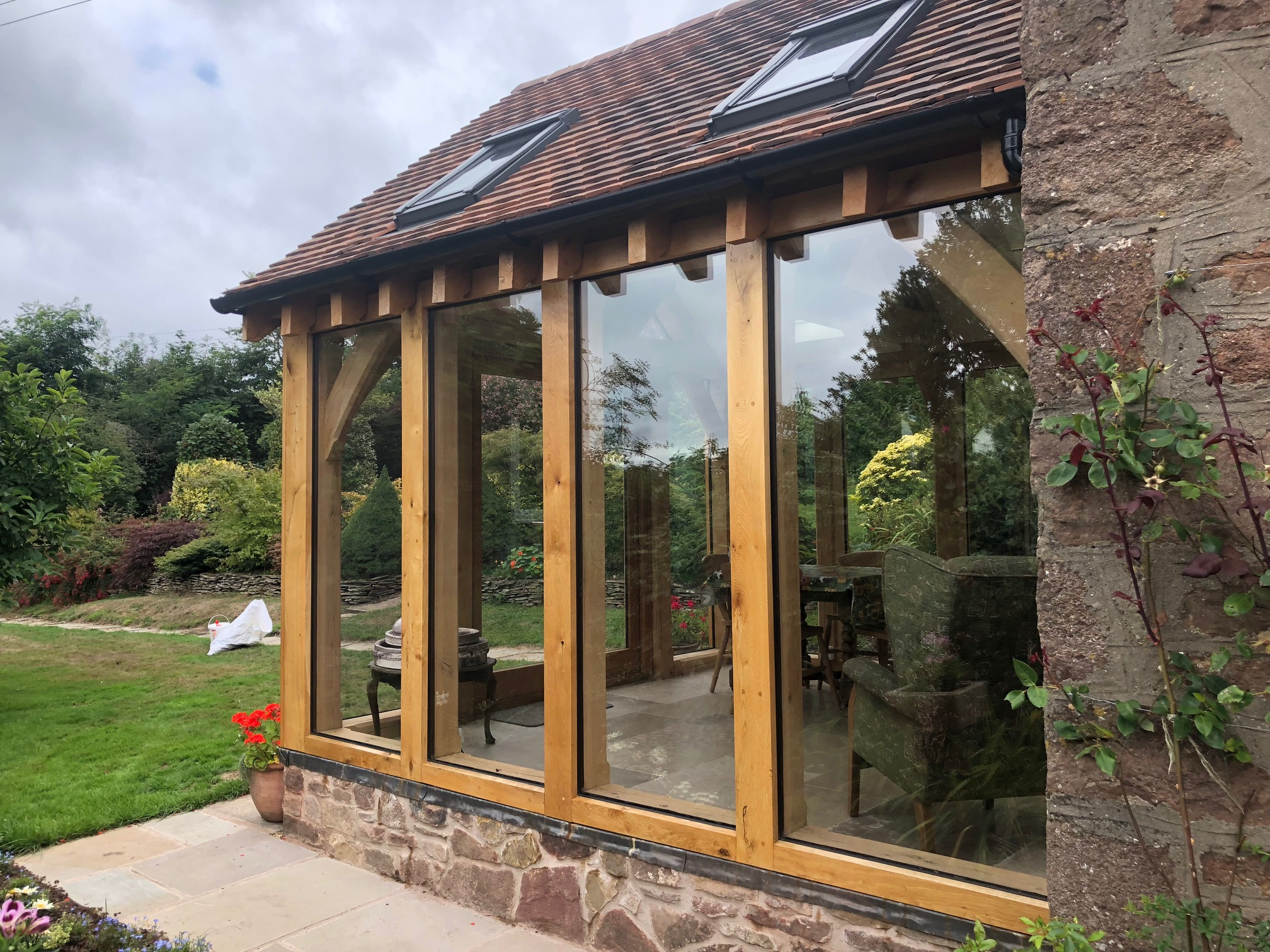 Oak conservatory with glass floor to ceiling