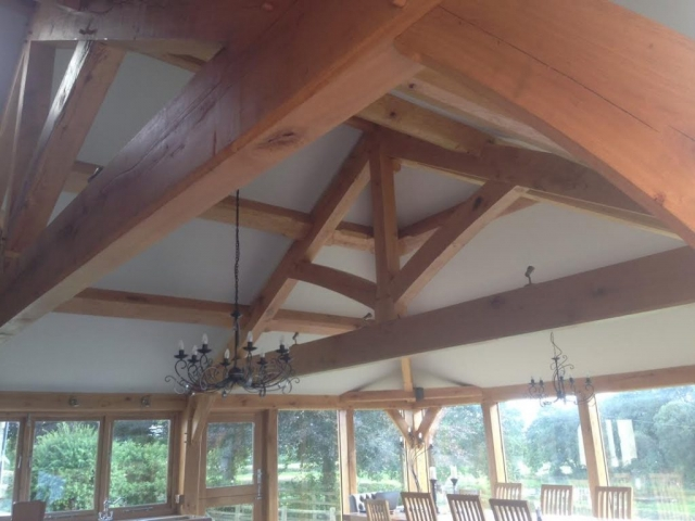 Oak truss and purlin set inside extension