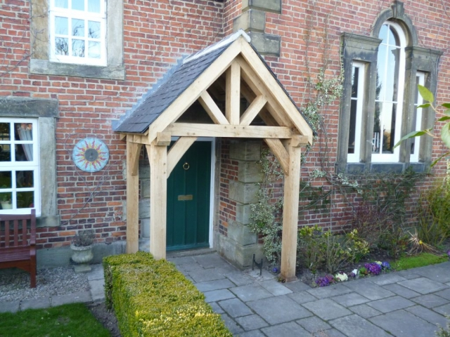 Oak porch with four posts and curved braces