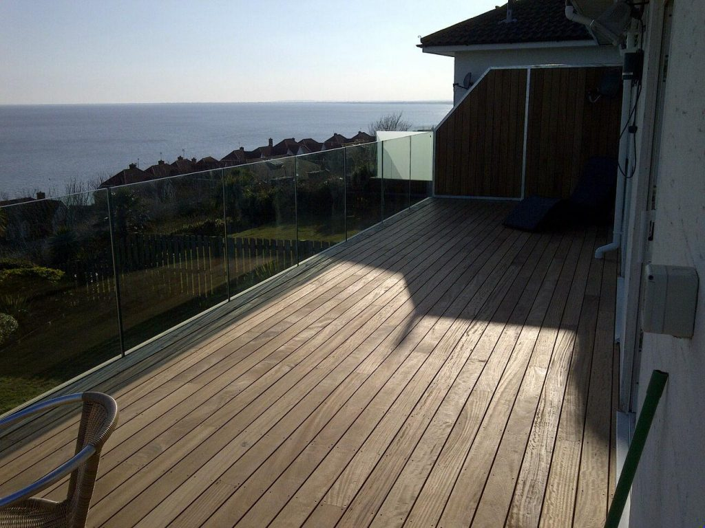 Oak and glass balcony with oak decking in kent