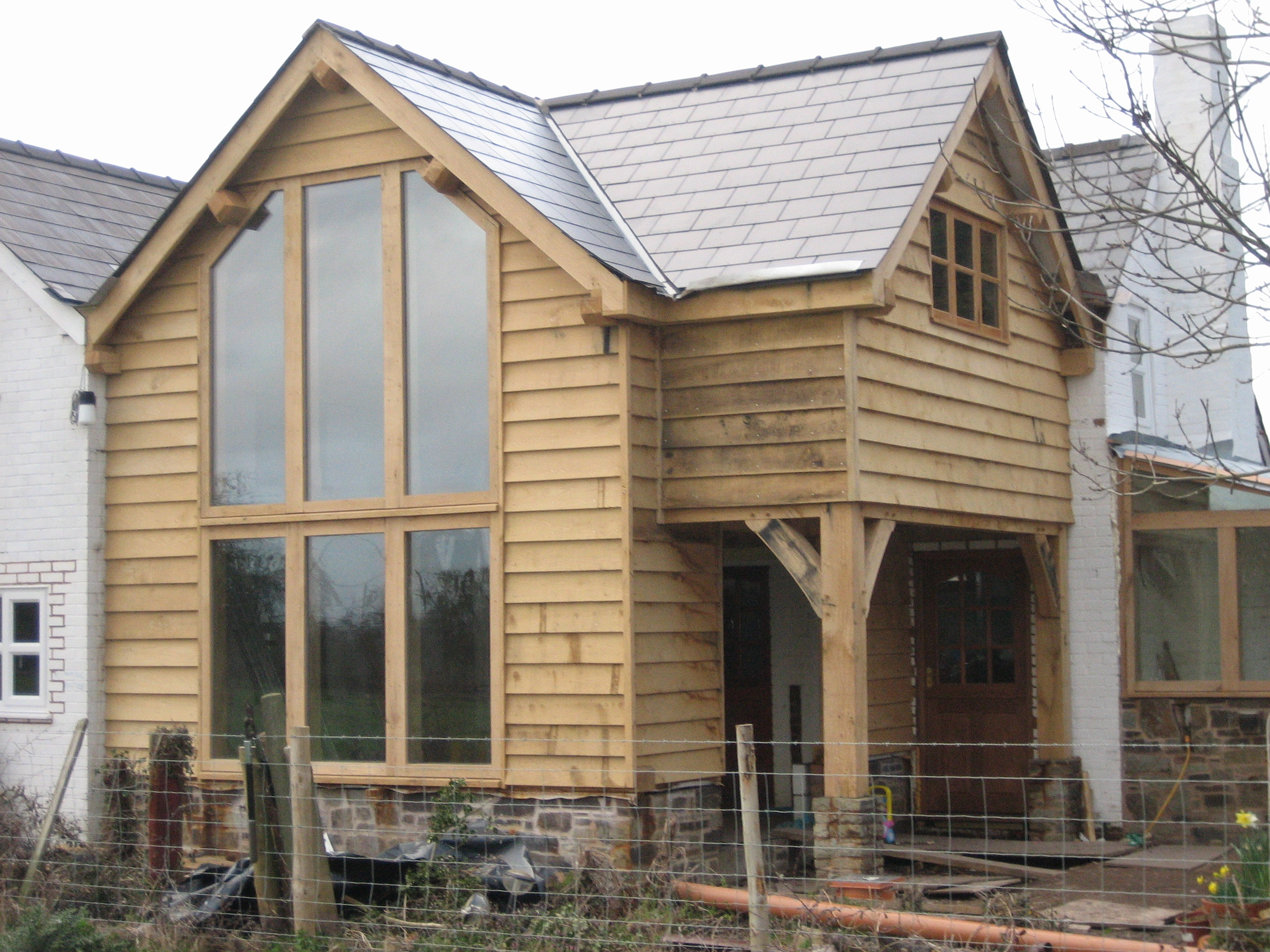 Oak and clad glazed extension