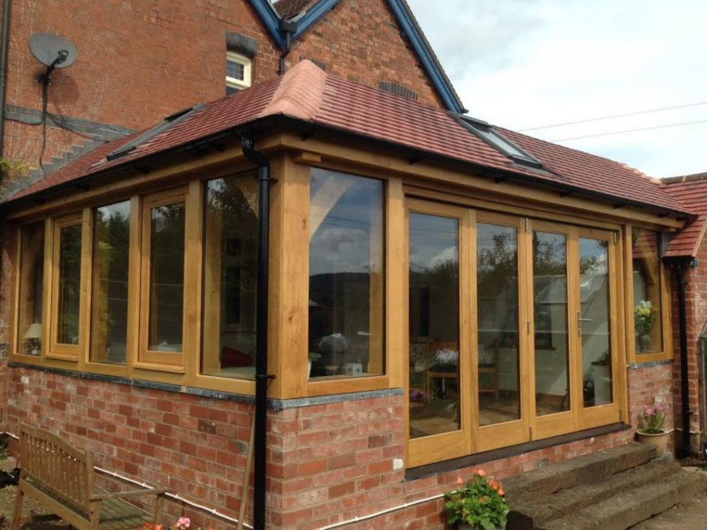 Oak framed orangery with bi-folding doors