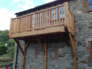 Oak framed balcony with large oak brackets