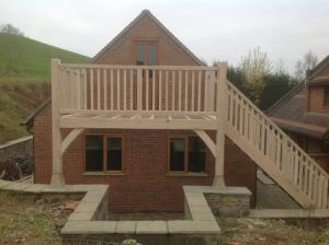 Oak framed balcony with stairs fitted to garage end