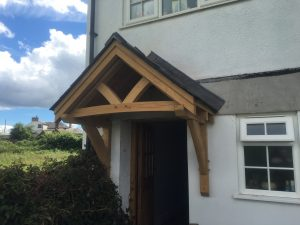 Oak canopy on rendered house