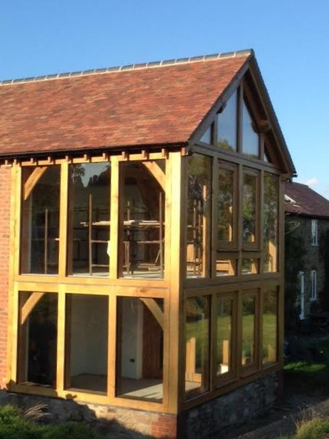Two storey oak and glass extension