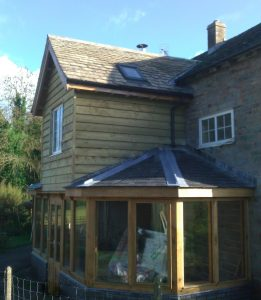 Oak framed extension with two storey middle bay