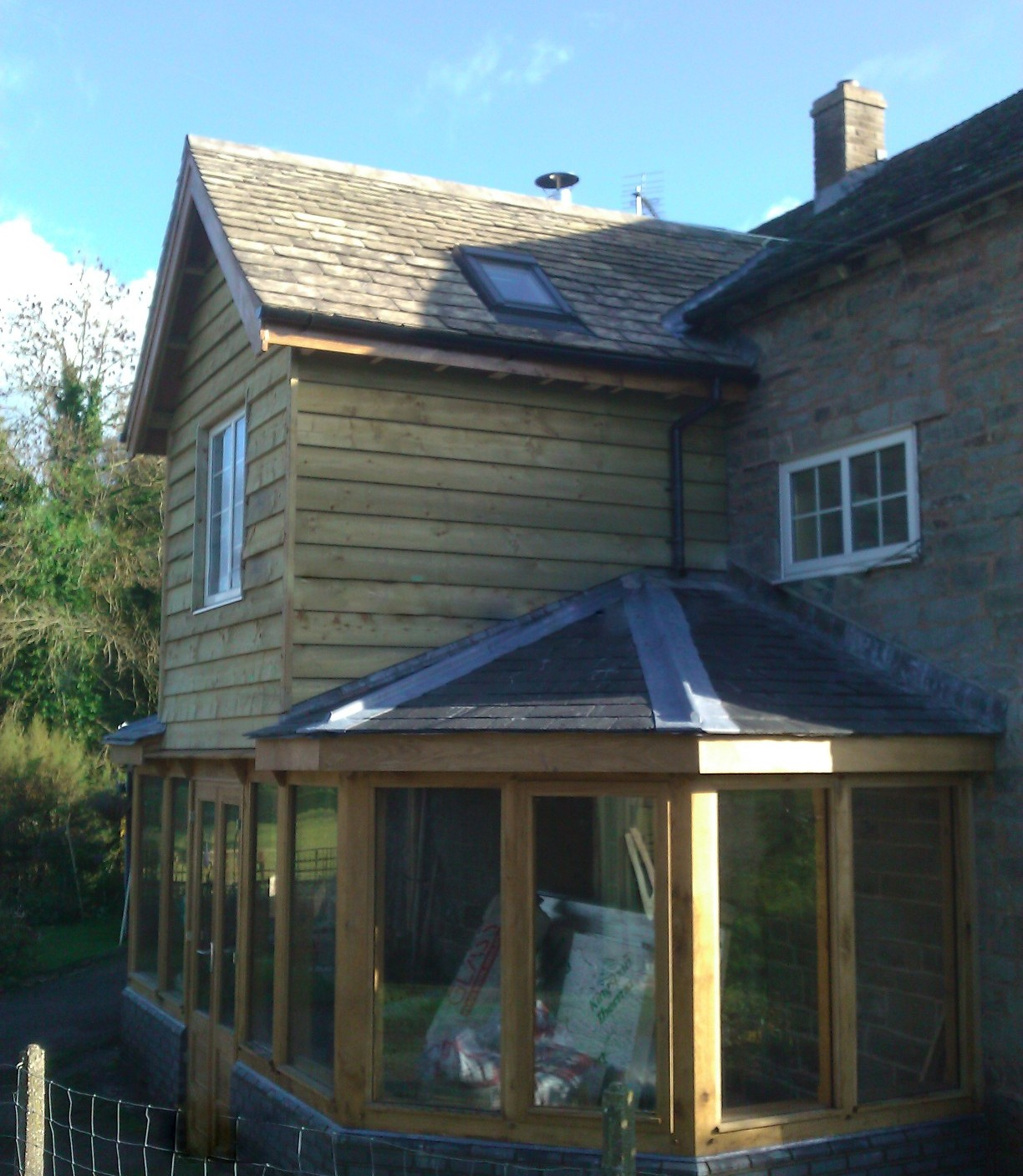 Oak framed extension with softwood clad