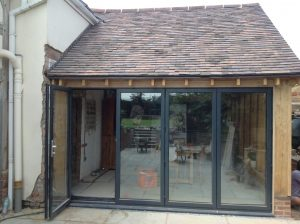 oak framed extension with aluminium bi folding doors