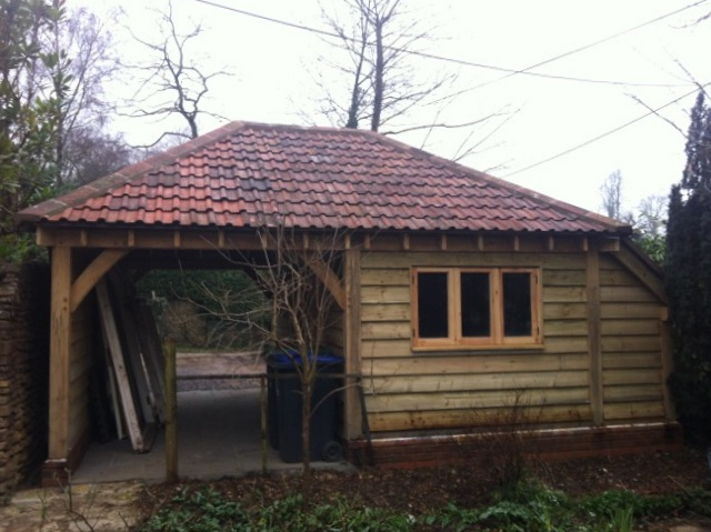 two bay oak garage with hip roof
