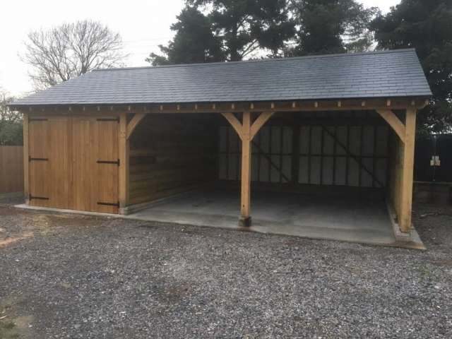 Triple bay oak garage with one bay enclosed