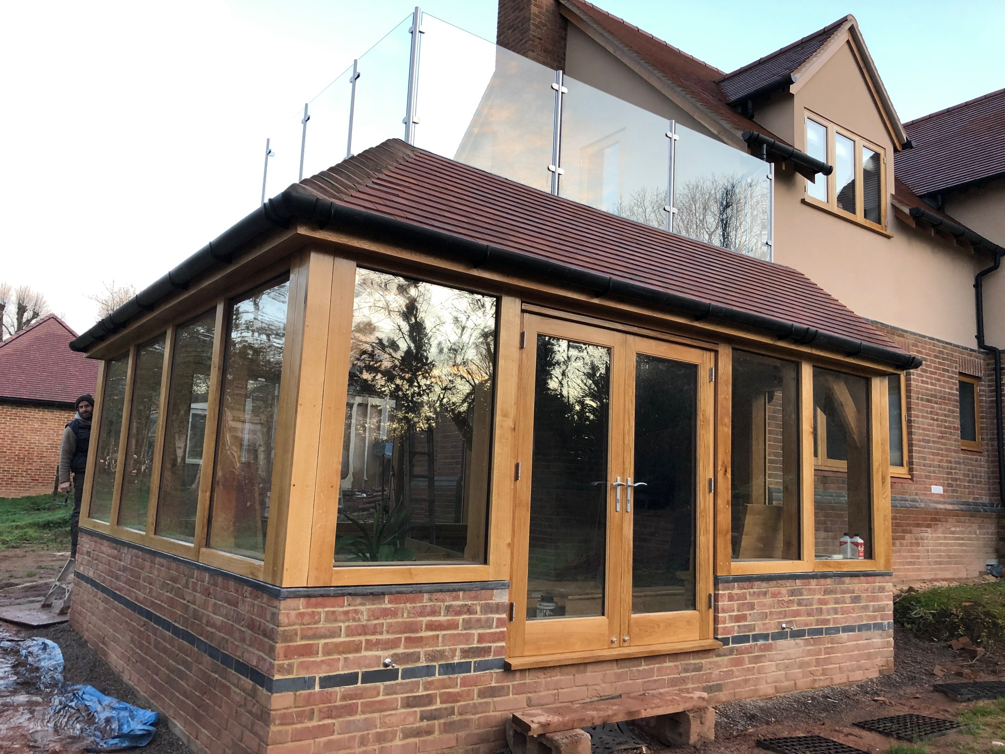 An oak framed garden room with balcony above