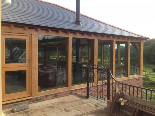 Large oak framed extension with hipped roof