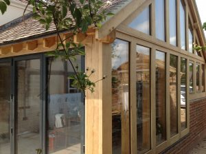Oak framed extension with aluminium bi-folding doors