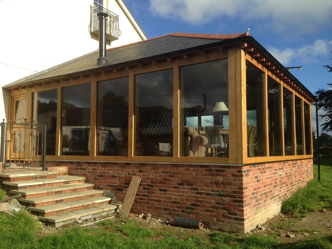 Large oak framed extension with glass