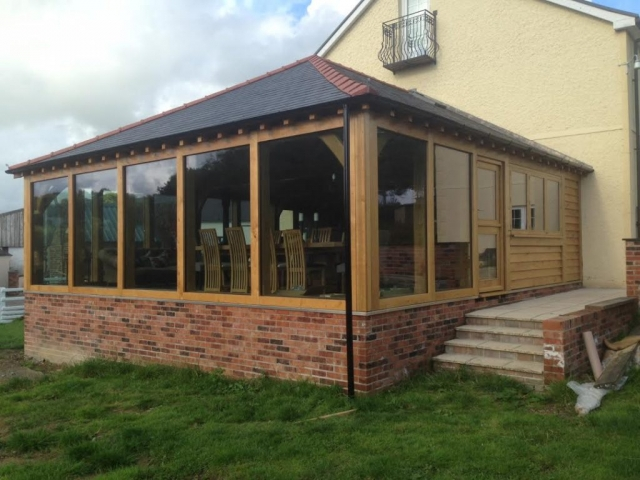 Oak framed extension with floor to ceiling glass