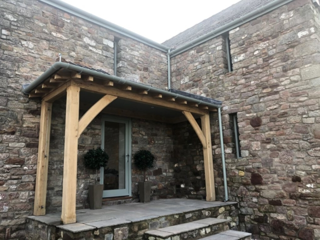 Oak framed lean too porch fitted onto a stone barn