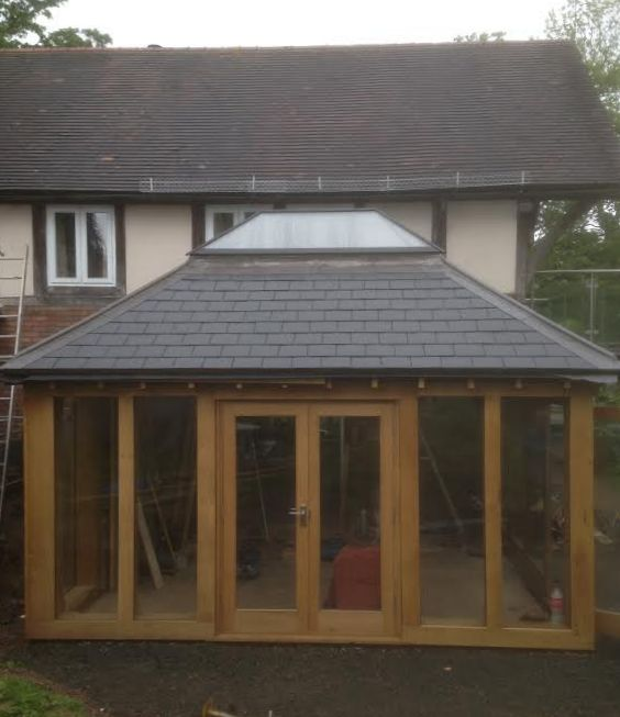 Oak orangery with slate roof and lantern