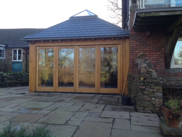 Oak orangery with bi-folding doors