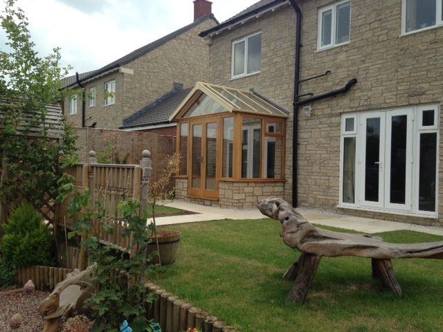 Enclosed oak porch fitted on stone wall