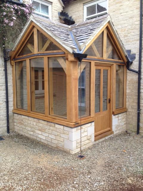 Corner oak framed porch with two gables