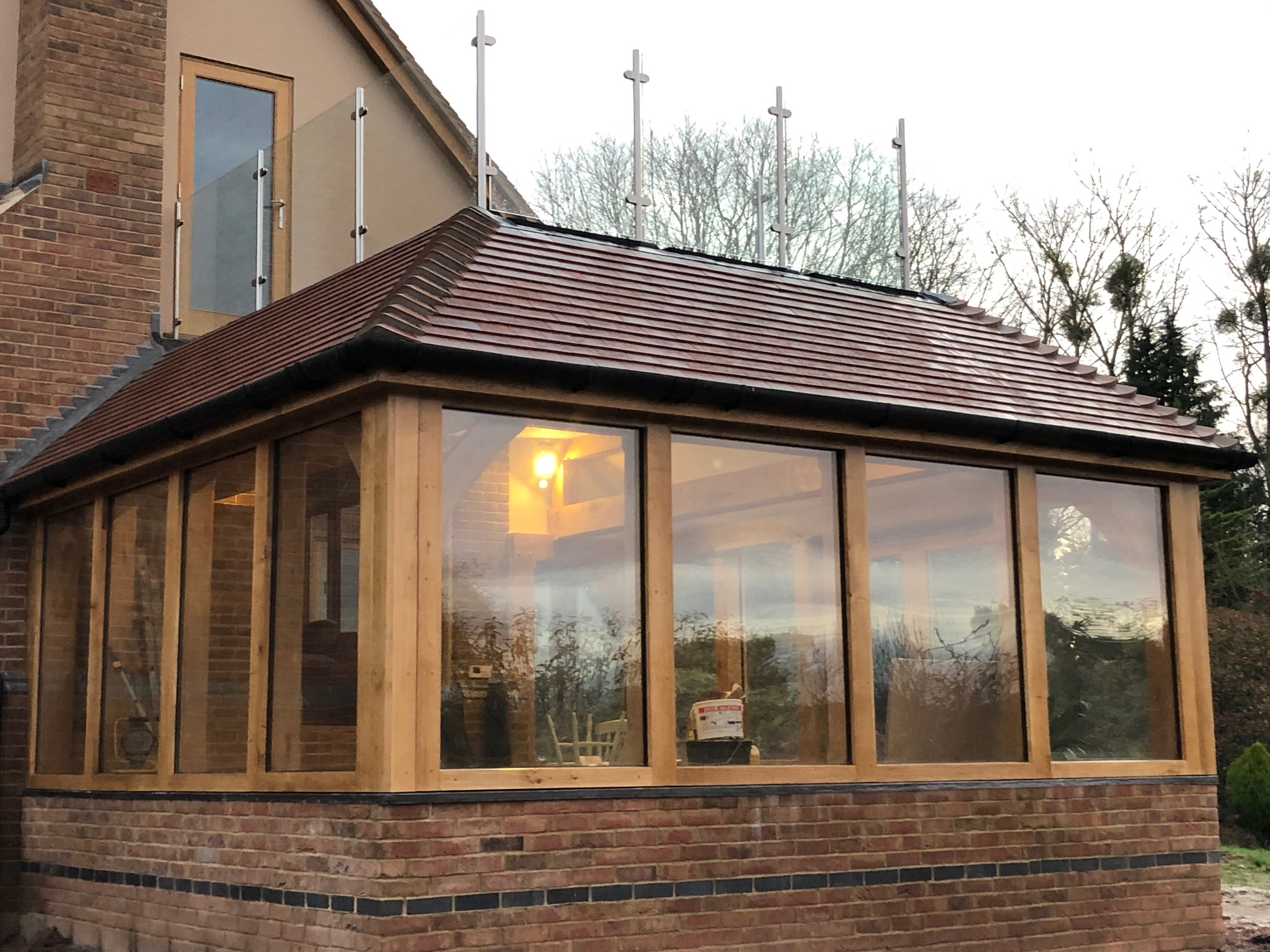 An oak framed garden room with balcony