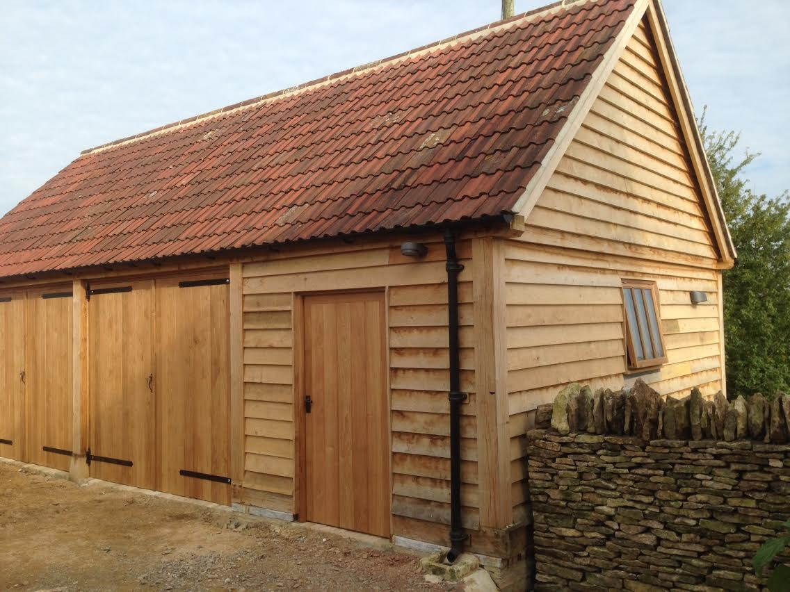 Triple bay oak garage enclosed with doors