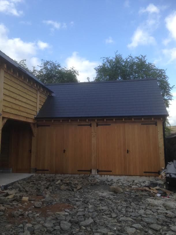 Large oak framed garage with carport and enclosed section