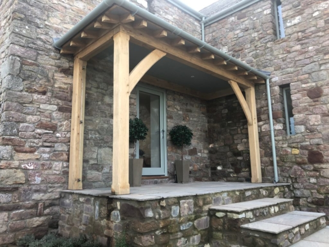 Oak lean too with a glazed side frame and hipped roof