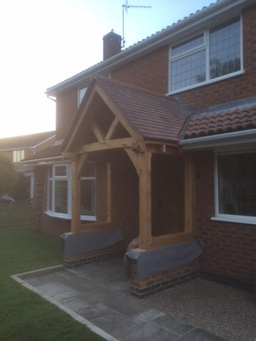 Open oak porch with curved braces