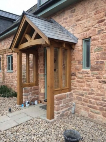 Oak porch on stone barn