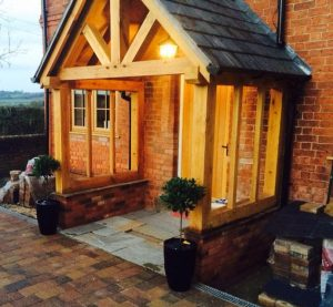 Open oak porch with slate roof