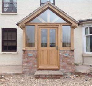 Enclosed oak porch with half height brick wall