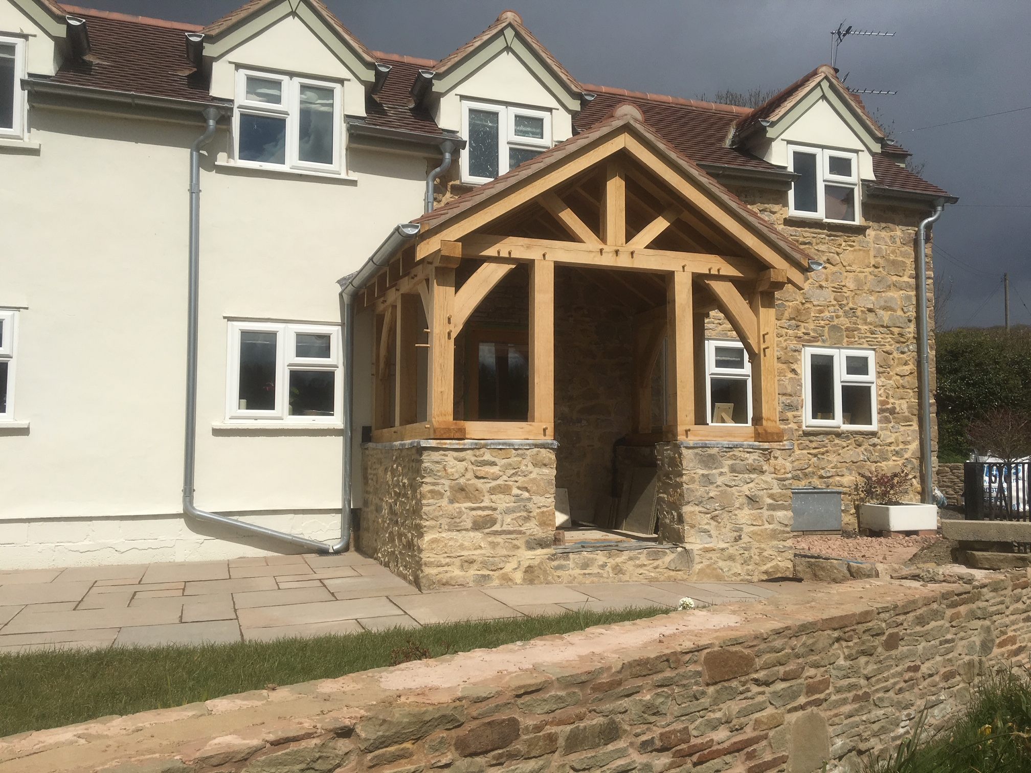 Oak framed porch sat on a stone wall