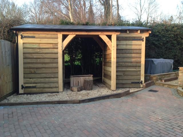 Oak framed shed with log store