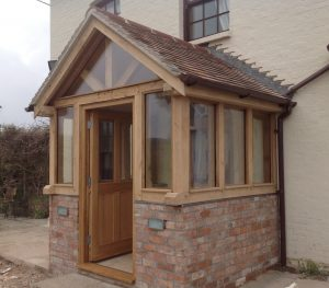Enclosed oak porch with glass and door