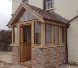 Enclosed oak framed porch on brick dwarf wall