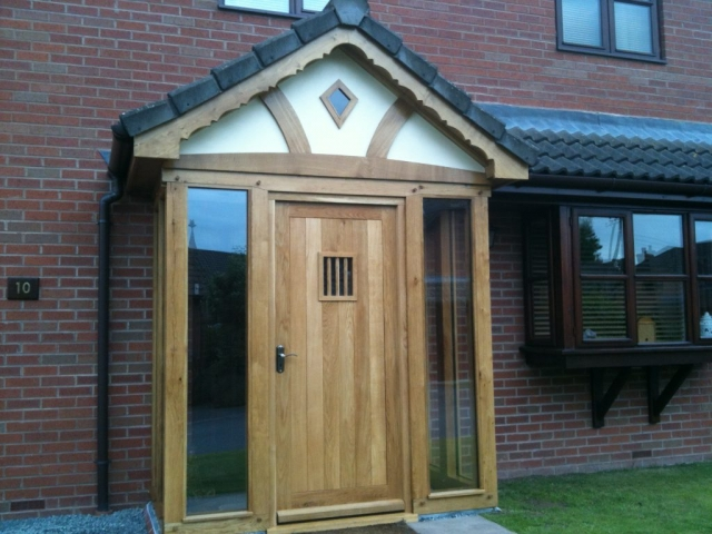 Enclosed oak framed porch with full length glass