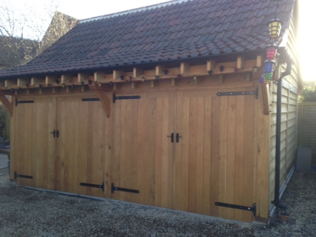 2 bay enclosed oak garage