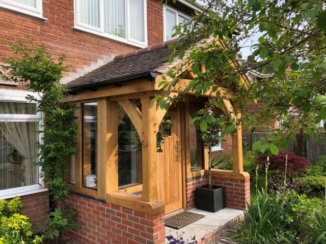 An enclosed oak framed porch with tiled roof