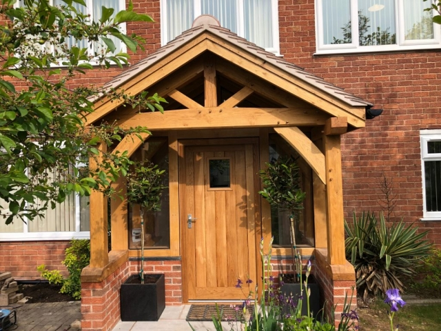 Enclosed oak framed porch Malvern with oak door and tiled roof