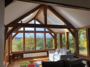 Internal view of oak framed garden room extension with king post truss