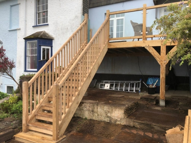 Oak framed balcony and glass balustrade